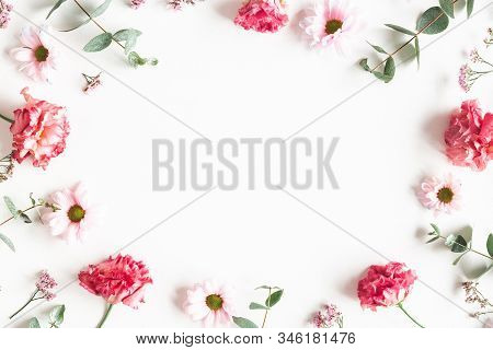 Flowers Composition. Frame Made Of Pink Flowers And Eucalyptus Branches On White Background. Valenti