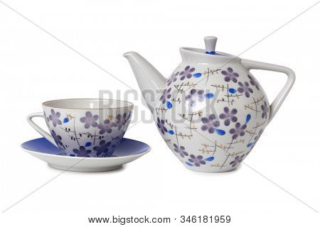 Vintage tea cups and teapot on table. Isolated objects on a white background