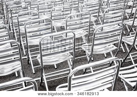 Shiny Metallic Chairs In Rows Prepared For Public Event. Empty Seats In Public Space.abstract Urban