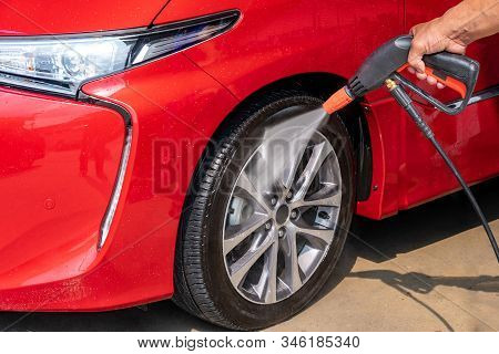 Cleaning The Wheels With A Water Gun ,car Wash Using High Pressure Water. Detail Of Manual Wheel Cle