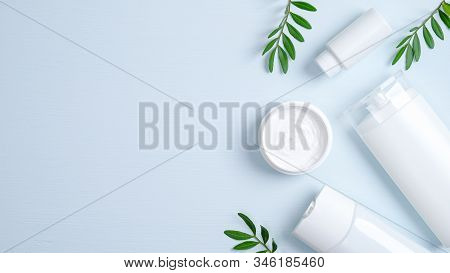Natural Organic Cosmetic Products Concept. Hair Care Herbal Cream In Jar, Shampoo Bottle, Shower Gel