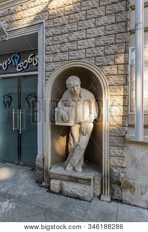 Kutaisi, Georgia, October 13, 2019 : A Statue Of An Elderly Man Stands In A Niche Wall On The Shota