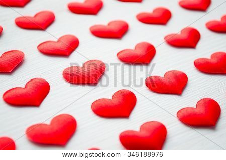St Valentines day background. Red hearts on the white background, space for text, St Valentines day festive concept, shallow DOF, St Valentines day festive concept. Romantic red hearts