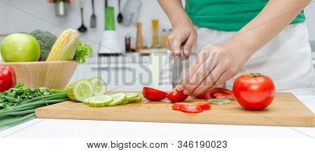 Banner. Young Pretty Woman In Green Shirt Cutting Cooking And Knife Preparing Fresh Vegetables Salad