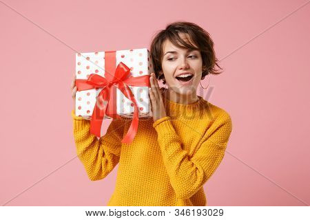 Curious Young Brunette Woman Girl In Yellow Sweater Posing Isolated On Pink Background. Valentines D