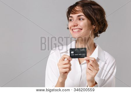 Pretty Young Business Woman In White Shirt Posing Isolated On Grey Wall Background Studio Portrait.