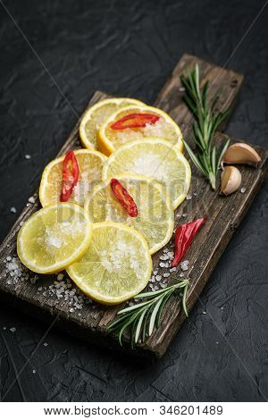 Ingredients For Salted Lemons On A Dark Background. Moroccan Cuisine.