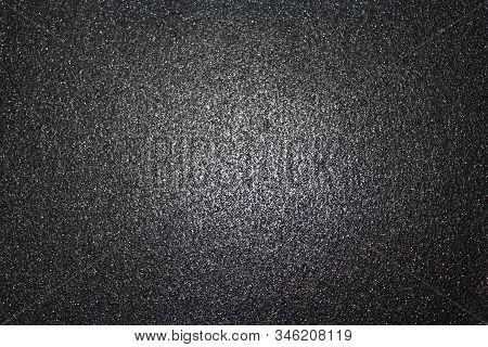 Black Glittery Background With Light In The Centre