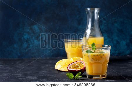 Smoothie Mango Passion Fruit In A Glass, Fresh Mango And Passion Fruit On A Dark Background