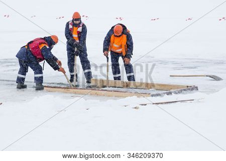Sailors Work At The Lane With A Fenced Wooden Formwork