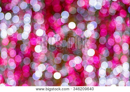 Holiday Lights Bokeh Background. Abstract Glitter Lights Pink And White, De-focused. Banner Celebrat