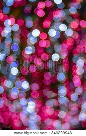 Holiday Lights Bokeh Background. Abstract Glitter Lights, De-focused. Celebration Glowing Design.