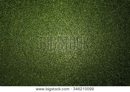 Green Glittery Background With Light In The Centre