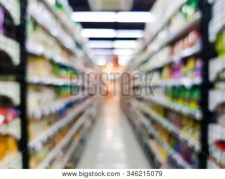 Blurred Defocus Shot Of Supermarket Shelf Display For Household Product. Many Consumer Goods Place F