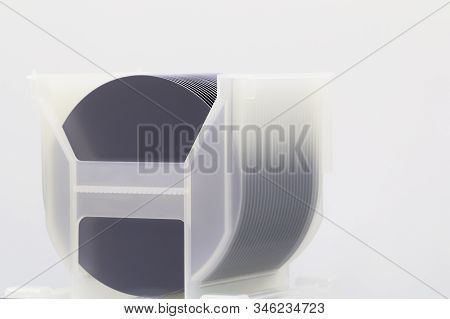 Silicon Wafers In White Plastic Holder Box On A Table- A Wafer Is A Thin Slice Of Semiconductor Mate