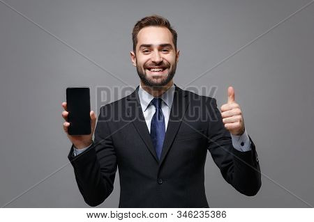 Funny Young Business Man In Suit Shirt Tie Posing Isolated On Grey Background. Achievement Career We