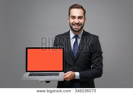 Smiling Young Business Man In Black Suit Shirt Tie Posing Isolated On Grey Background. Achievement C