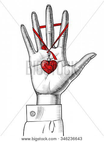 Female hand palm with a red heart decorative medallion on the ribbon. Vintage color engraving stylized drawing