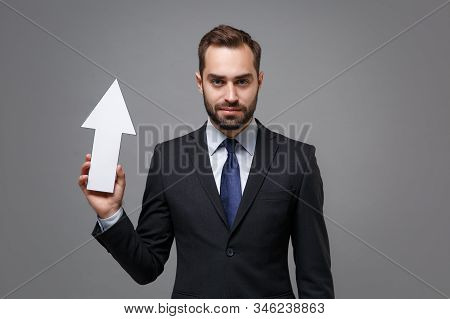 Serious Young Bearded Business Man In Classic Black Suit Shirt Tie Posing Isolated On Grey Backgroun