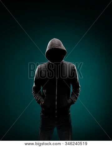 Computer Hacker In Hoodie. Obscured Dark Face. Data Thief, Internet Fraud, Darknet And Cyber Securit