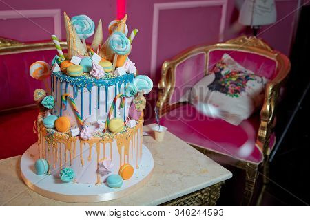 Blue Cake With Colorfull Small Sweet Ball . Decoration For Cake And Bekery. Colorfull Cake Pops In W
