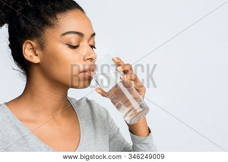 Thirsty Young African Woman Holding Glass Of Drinking Water For Body Health, Healthy Lifestyle, Thir