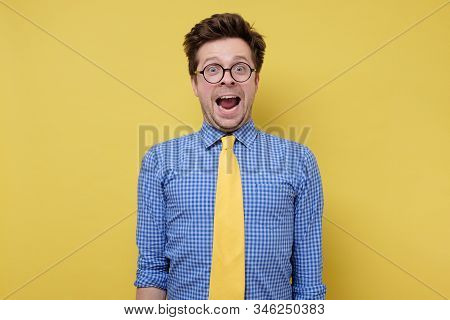 Goofy Young Man With Funny Hair Style Being Excited Full Of Joy.
