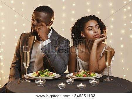 Afro Man And Woman Being Unhappy Because Of Troubled Date In Restaurant