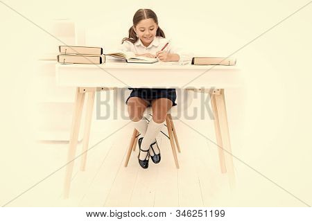 What Should Be Height Of Study Table. Schoolgirl Doing Homework At Table. Adorable Pupil Little Girl