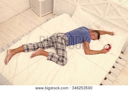 Time To Wake Up. Man Handsome Guy Lay In Bed With Alarm Clock. Get Enough Amount Of Sleep. Tips Slee