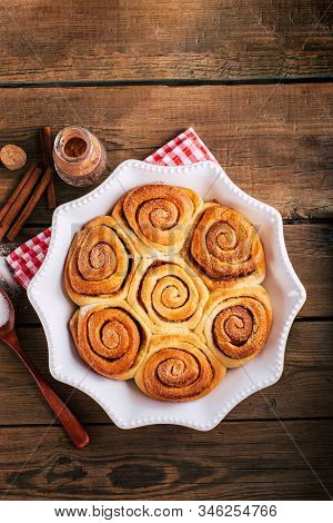 Sweet Cinnamon Rolls On A Wooden Table, Homemade Cakes