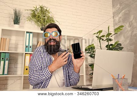Crazy About Technology. Bearded Man In Funky Glasses Using Smartphone With Mobile Technology. New Te