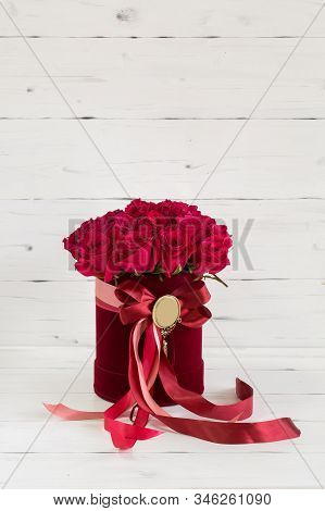 Red Velvet Box With Roses. Decorated With Red Ribbon.