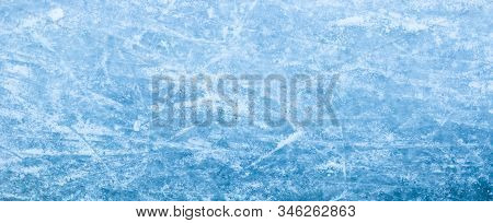 Abstract Ice Texture. Nature Blue Background. Traces Of Blades Of Skates On Ice