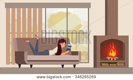 Girl Reading Book At Home Illustration. Young Woman On Sofa Enjoying Cozy Atmosphere With Burning Fi