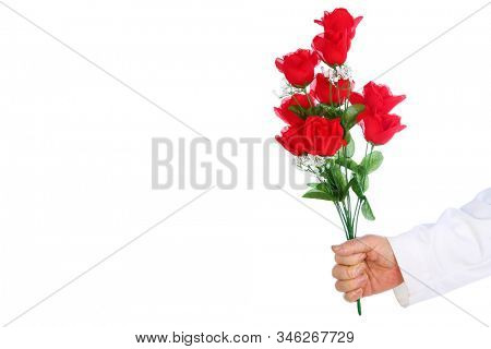 Doctors arm with Red Rose. A doctor or surgeon holds a long stem red rose. Isolated on white. Room for text. Clipping Path. Doctors deserve love and affection. Happy Valentines Day. Long Stem Roses.