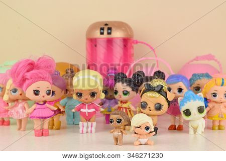 Many Colorful Plastic Lol Dolls On Table. Lol Surprise Series Toys Manufactured By Mga Entertainment