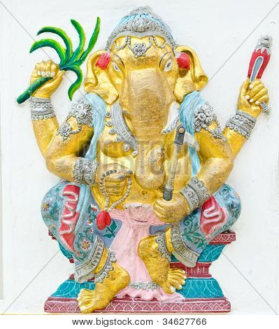 God of success 15 of 32 posture. Indian style or Hindu God Ganesha avatar image in stucco low relief technique with vivid color Wat Samarn Chachoengsao Thailand. poster