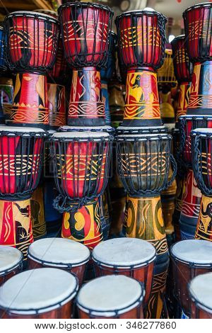 Coilorful Drums For Sale Inside Traditional Instrument And Musical Shop On The Street In The Old Tow