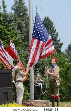 Boy Scouts Raising The Flag