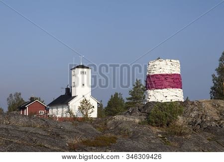 Nordmaling, Sweden On September 01. View Of A Former Lighthouse And A Red, White Stone Cairn From Th