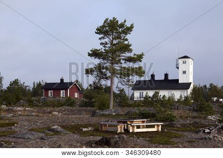 Nordmaling, Sweden On September 01. View Of A Former Lighthouse And A Red Cabin From The Seaside On