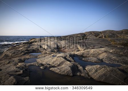 View Of The Shore Of The Baltic Sea Up North. Cliff, Rocks And Islands. Barren.