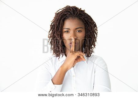 Businesswoman Gesturing For Silence And Looking At Camera. Serious Young African American Businesswo