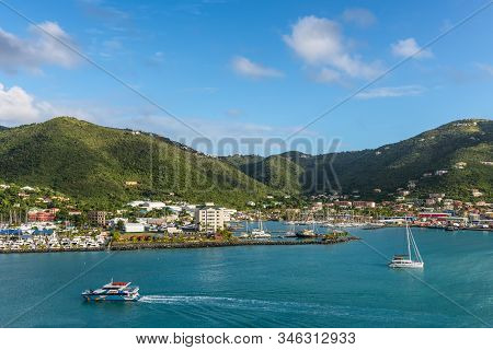 Road Town, Tortola - December 16, 2018: Coastline Along A Road Town In Tortola, Bvi. The Wooded Hill