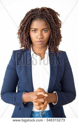 Serious Young Businesswoman Looking At Camera. Portrait Of Beautiful Confident Young African America
