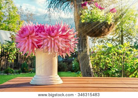 Bouquet Of Dahlias In A Vase On A Garden Wooden Table On A Bright Sunny Day. Flowers In A Vase Outdo