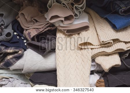 Messy Home Closet. Clutter Clothes In The Wardrobe. Heap Of Clothes