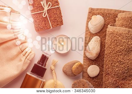 Spa and wellness concept, natural coffee scrub soap in cotton eco bag,essential oil cosmetic,peeling sand stone,towel,wooden haircomb.Beige dayspa set.Pastel bathroom accessories and products top view poster