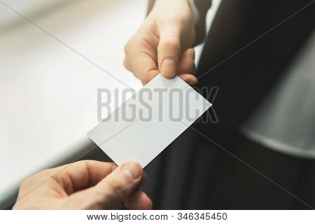 Close Up Of People Swapping Blank Business Card. Mockup